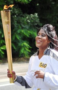 2012 london olympics sustainability -Tessa Sanderson, Olympic legend running with Olympic Games Torch